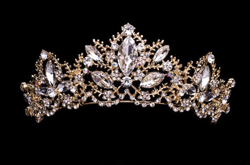 gold diadem with diamonds isolated on back