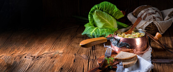 young and fresh cabbage cooked with bacon cubes