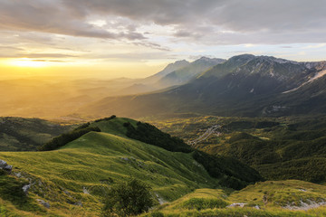 An Amazing Mountain View with Fog Atmosphere in the Sunrise Time - View of Mountains called Centenario from Prati di Tivo