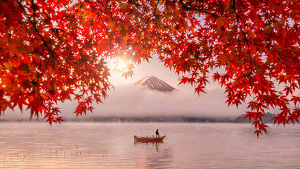 Red autumn leaves, boat and Mountain Fuji