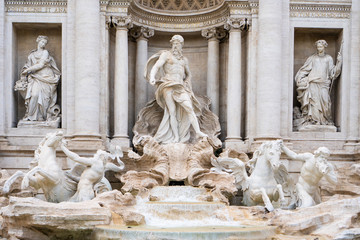 The Trevi fountain with Oceanus, god of the sea, in the center in Rome, Italy