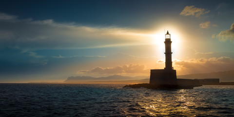 A beautiful night sky behind a shining lighthouse. Chania, Crete, Greece