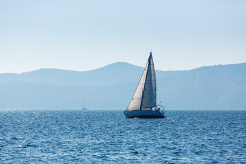 Sailing yacht boat at the Sea. Luxury cruise yachting.