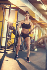 Exercise with rope in fitness club