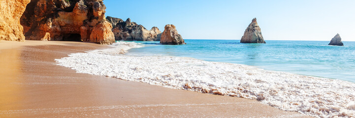 Summer sandy beach (Algarve, Costa Vicentina, Portugal).  Beautiful natural summer vacation travel concept.