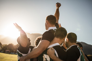 Rugby team celebrating the victory
