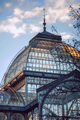 Transparent building at sunset, glass palace of the park of the retirement of Madrid