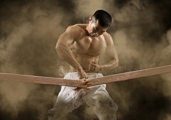 karate man breaking with hand wooden board