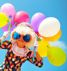 funny kid clown with balloons