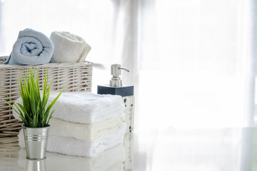 white towels on white table with copy space on bright room background