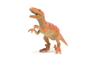 Plastic velociraptor toy isolated on white background