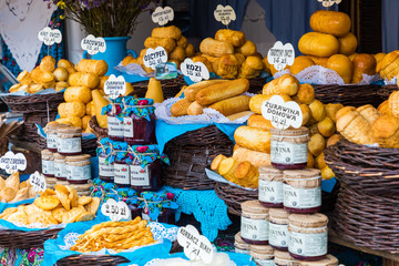 Traditional polish smoked cheese oscypek on christmas market in Cracow. Oscypek is made exclusively in Tatra Mountains region of Poland