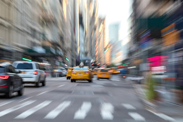 Abstract blurred scene with taxis in motion through the streets of New York City
