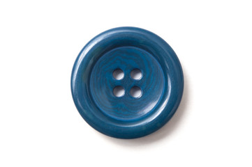 closeup of blue sewing buttons on white background