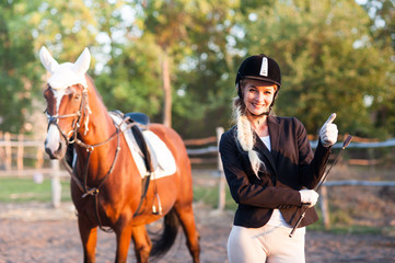 A beautiful girl rider walks with a horse. Horse theme