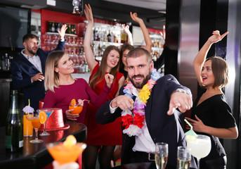 Man having fun on Hawaiian party at nightclub