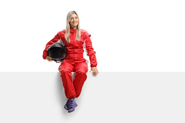 Female racer in a suit sitting on a panel