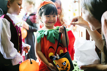 Little children trick or treating on Halloween