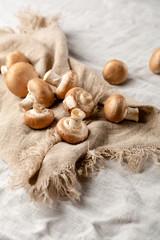 Raw mushrooms on napkin
