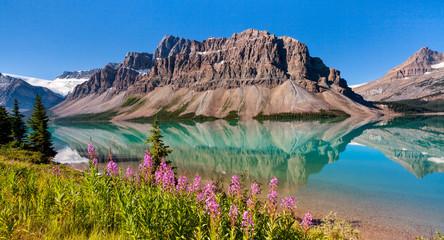 Waputik Range reflecting on Bow Lake, Banff National Park, Alberta Canada