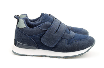Pair of blue child suede sport shoes