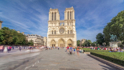 Front facade of cathedral of Notre Dame de Paris, with square full of people in front timelapse hyperlapse
