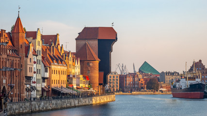 City Gdansk with the oldest medival port crane called Zuraw and a promenade along the riverbank of Motlawa River.