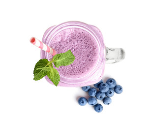 Tasty blueberry smoothie in mason jar on white background, top view