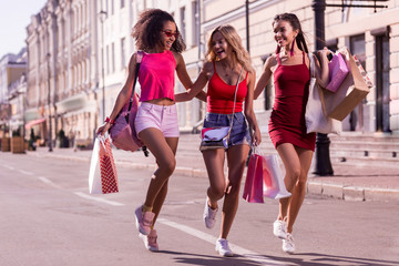 So much fun. Delighted happy women laughing while enjoying their walk