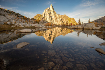 A person standing in front of Prusik Peak in the Enchantments - Washington