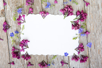 Flower arrangement on a wooden background. View from above.