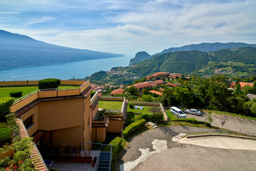 View of the Lake Garda from Tremosine, Italy.Panorama of the gorgeous Garda lake surrounded by mountains in the springtime on a cloudy day and a strong storm