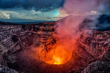 Masaya Volcano crater with burning lava and smoke