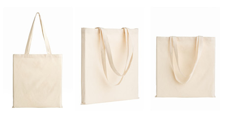 set of bags made of white cotton fabric, isolated on white background