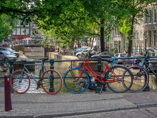 Beautiful view of Amsterdam canals with bridge and bikes. Amsterdam, Netherlands