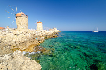 amazing view on windmill and azure sea in Rhodes town, Greece
