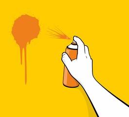 Man hand using orange spray painting