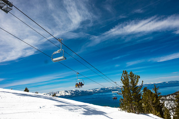 Lake Tahoe from Heavenly Resort - skiing - looking at ski lift with lake in background - space for text top right