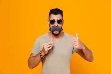 Portrait of a happy young casual man in sunglasses
