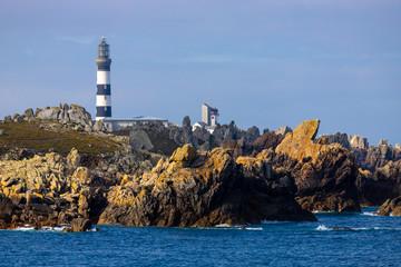 The Creach lighthouse and rocky coastline