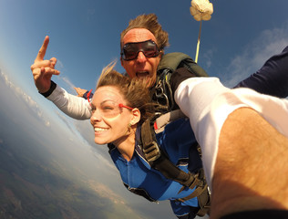 Selfie tandem skydiving with pretty woman