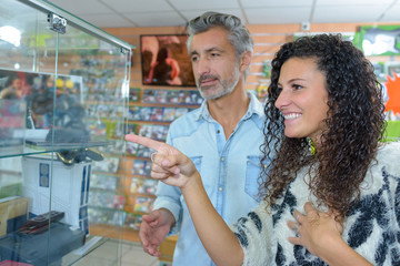 couple shopping together pointing at something
