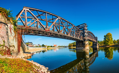Old Town Railway Bridge in Magdeburg, Elbe river and downtown at Autumn