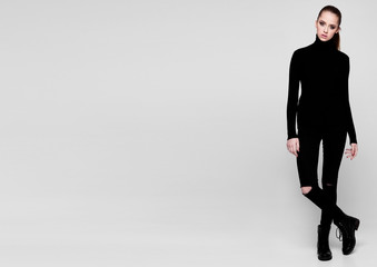 Young beautiful fashion model wearing black polo