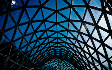 Steel structure geometry construction as the background . Metal rooftop structure with glass from Musee du Louvred