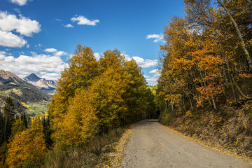 High mountain Colorado forest road in the fall with views.