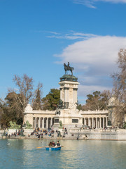 Beautiful picture of tourists on boats at Monument to Alfonso XII in the Parque del Buen Retiro. in Madrid, Spain