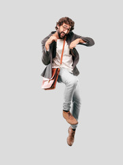 young bearded businessman wearing blazer and jumping. success or