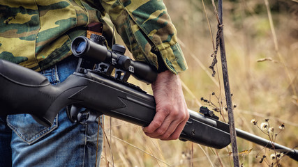 shooter engaged in sports hunting with air rifle