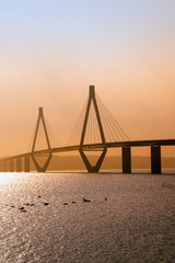 faro bridge in sunset light, the highway bridge over the Storstroem in denmark connects the islands and is a part of the vogelfluglinie (bird flight line), copy space